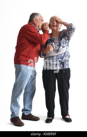 Senior couple, whispering secrets - Stock Photo