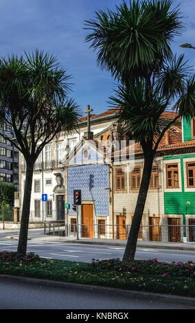 Town houses and Senhor da Boa Nova Chapel on Rua de Dom Manuel II street in Porto city, second largest city in Portugal. - Stock Photo