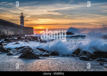 View from Carneiro beach on a Felgueiras Lighthouse during sunset over Atlantic Ocean in Foz do Douro district of - Stock Photo