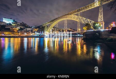 View from Vila Nova de Gaia city on Porto riverfront and Dom Luis I Bridge over Douro River, Portugal. - Stock Photo