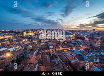 Evening in Porto, second largest city in Portugal. Aerial view from bell tower of Clerigos Church with Se Cathedral - Stock Photo