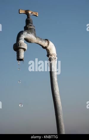 A old faucet that loses. - Stock Photo