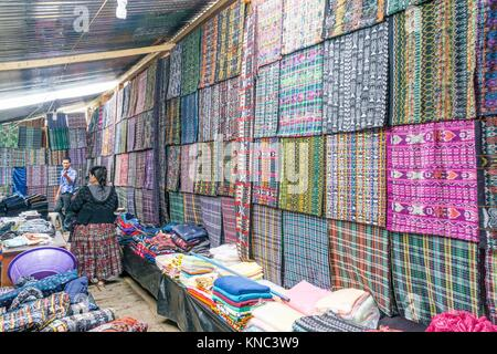 Fabric market, Lancetillo, La Parroquia, zona Reyna, Quiche, Guatemala, Central America. - Stock Photo
