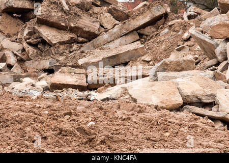 Pile of rubble from a dismantled building at a demolition site - Stock Photo