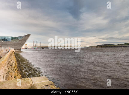 Dundee, Scotland, UK - December 05, 2017: Tay Bridge looking past the new waterfront museum over to the oil platform - Stock Photo