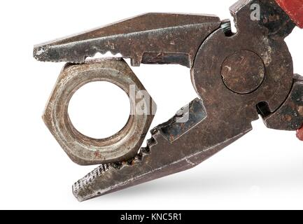Closeup of old pliers and nut isolated on white background. - Stock Photo