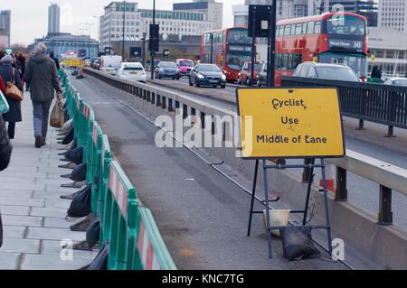 Anti-vehicle barriers on pavement of Waterloo Bridge installed after terror attack at London Bridge, London, UK - Stock Photo