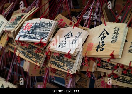 Tokyo, Japan - May 14, 2017: Ema, small wooden plaques with wishes or prayers written on them. - Stock Photo