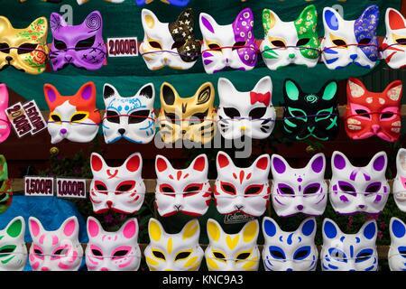 Tokyo, Japan - May 14, 2017: Cat masks for sale hanging on the wall at the Kanda Matsuri Festival. - Stock Photo