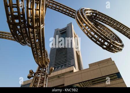 Yokohama, Japan - June 15, 2017: Futuristic stainless steel construction and the Landmark tower on Queen's Square - Stock Photo
