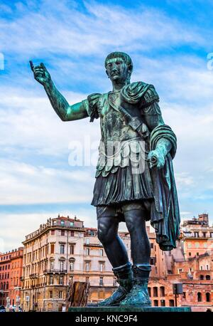 August Caesar Bronze Statue Buildings Rome Italy. Modeled on ancient statue of Augustus Cesar. - Stock Photo