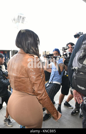 LOS ANGELES, CA - AUGUST 03: Pregnant Kim Kardashian Unveils Shorter Haircut at LAX on August 3, 2015 in Los Angeles, - Stock Photo