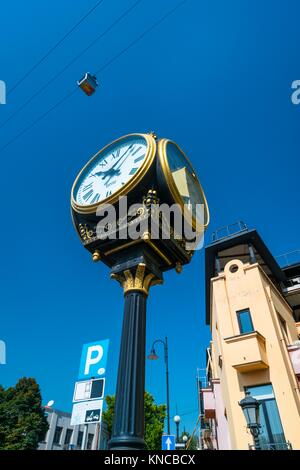 Clock and aerial tramway. Tbilisi City, Georgia, Middle East. - Stock Photo