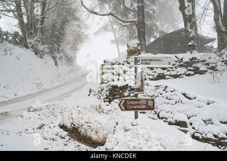 Snowshill village sign in the snow in December. Snowshill, Cotswolds, Gloucestershire, England - Stock Photo