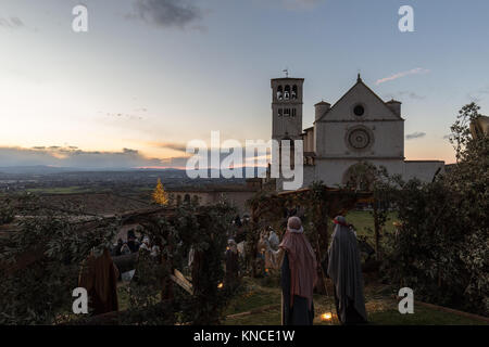Christmas 2017 in Assisi (Umbria), with a view of San Francesco papal church, nativity scene  and lighted tree - Stock Photo