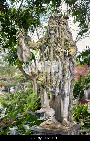 Statue of Rangda, the demon queen, in the  Tirta Gangga water palace. Karangasem regency, Bali, Indonesia. - Stock Photo