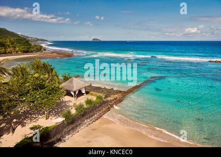 Aerial view of the Mendira Bay near Candidasa village. Manggis subdistrict, Karangasem regency, Bali, Indonesia. - Stock Photo