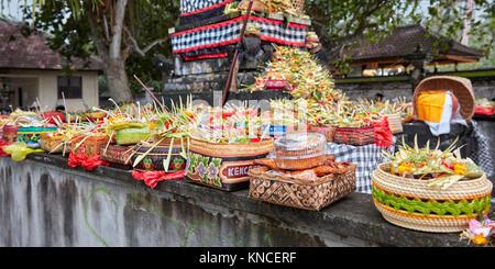 Open-air altar with offerings at local temple. Sengkidu village near Candidasa, Karangasem Regency, Bali, Indonesia. - Stock Photo