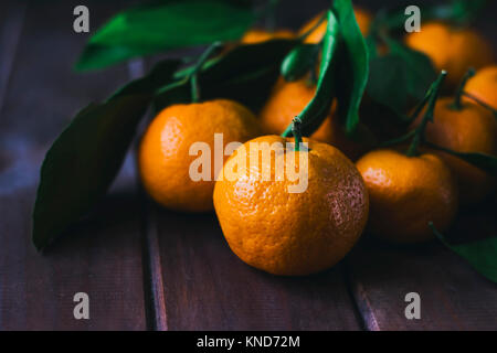 Fresh tangerines on wooden background. Close up - Stock Photo