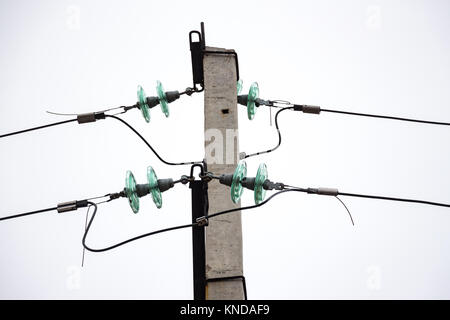 Glass Insulators on power lines - Stock Photo