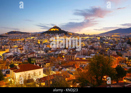 View of Lycabettus hill from Anafiotika neighborhood in the old town of Athens, Greece. - Stock Photo
