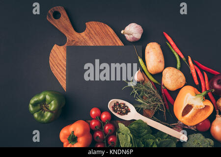 top view of black board on wooden table - Stock Photo