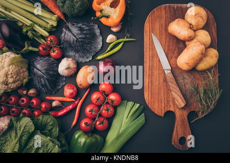 ripe vegetables and wooden board - Stock Photo