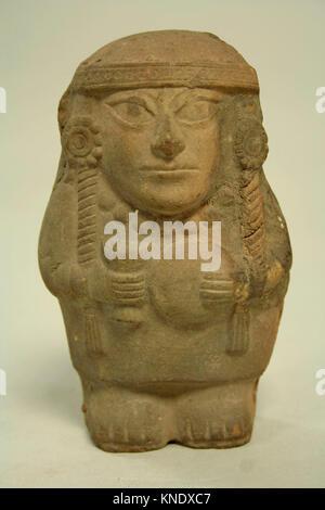 Standing Ceramic Figure Holding Disk. Date: 4th-5th century; Geography: Peru; Culture: Moche; Medium: Ceramic; Dimensions: - Stock Photo