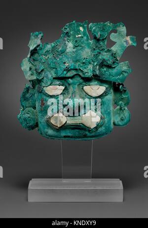 Ornamental mask. Date: 390-450; Geography: Peru; Culture: Moche (Loma Negra); Medium: Silvered copper, shell; Dimensions: - Stock Photo