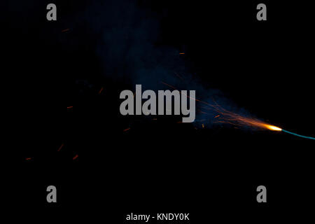 Burning fuse with sparks and blue smoke isolated on black background Burning fuse with sparks and blue smoke on - Stock Photo