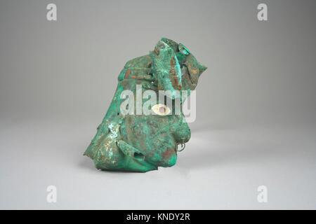 Face Mask Ornament. Date: 390-450; Geography: Peru; Culture: Moche (Loma Negra); Medium: Copper-gilded, shell; Dimensions: - Stock Photo