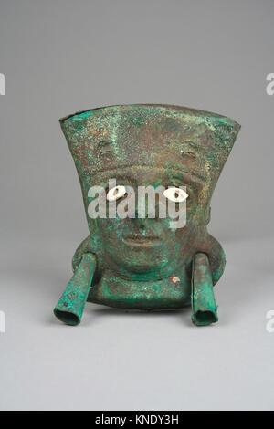 Face Mask Ornament. Date: 390-450; Geography: Peru; Culture: Moche (Loma Negra); Medium: Gilded copper, shell; Dimensions: - Stock Photo