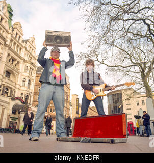 Junior Senior a pop duo from Denmark, photographed busking in , Leicester Square,London England, United Kingdom. - Stock Photo