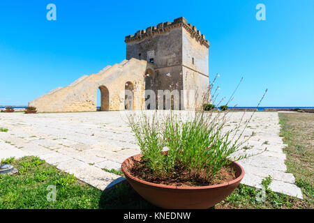 Picturesque historical fortification tower Torre Lapillo (St. Thomas Tower) Torre di San Tommaso on Salento Ionian - Stock Photo