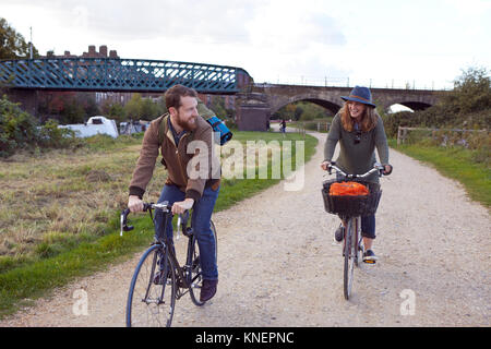 Couple enjoying cycling on marshes - Stock Photo