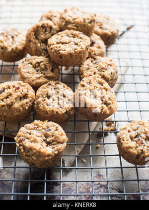 Gluten free, multi-grain cookies on cooling rack, close-up - Stock Photo