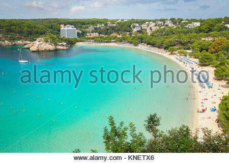 View of holiday makers on sandy beach at Cala Galdana, Menorca, Balearic Islands, Spain - Stock Photo