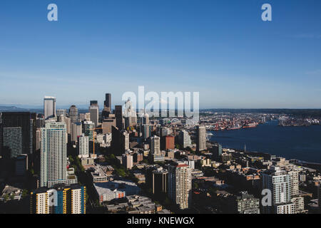 A view of downtown Seattle and Mount Rainier. seen from the top of the Space Needle. - Stock Photo
