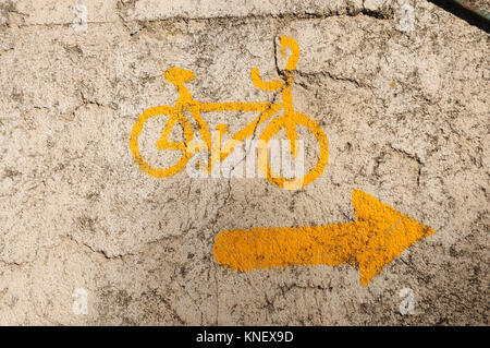 A cycle specific sign painted on rock on the Via de la Plata pilgrim route in Spain. Waymarkers on the route are - Stock Photo