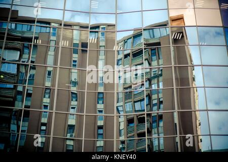 Reflection of a building in Azca financial district in Madrid, Spain. - Stock Photo