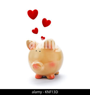 Piggy bank with red hearts above - Stock Photo