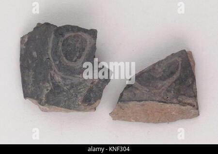 Vase fragment. Period: Archaic; Date: ca. 580-550 B.C; Culture: Etruscan; Medium: Terracotta; bucchero pesante; - Stock Photo