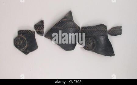 Vase fragment. Period: Archaic; Date: 550 B.C; Culture: Etruscan; Medium: Terracotta; bucchero pesante; Dimensions: - Stock Photo