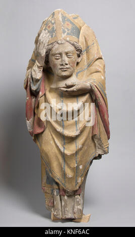 Saint Denis. Date: 14th century; Culture: French; Medium: Stone, paint; Dimensions: Overall: 24 1/2 x 10 1/8 x 5 - Stock Photo