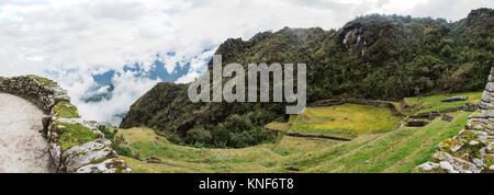 Panoramic image of ruins on Inca trail, Machu Picchu, Cusco, Peru, South America - Stock Photo