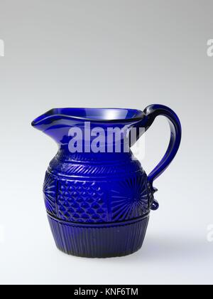Pitcher. Date: 1820-40; Geography: Made in United States; Culture: American; Medium: Blown-molded glass; Dimensions: - Stock Photo