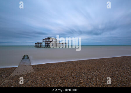 West Pier, old pier, remains of structure at Brighton, East Sussex, England UK in December - long exposure - Stock Photo