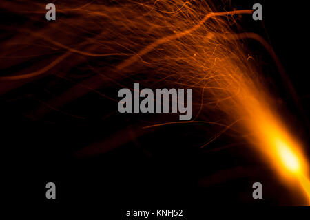 Burning fuse with sparks isolated on black background - Stock Photo
