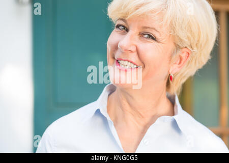 Close-up portrait of a cheerful senior woman with good health an - Stock Photo