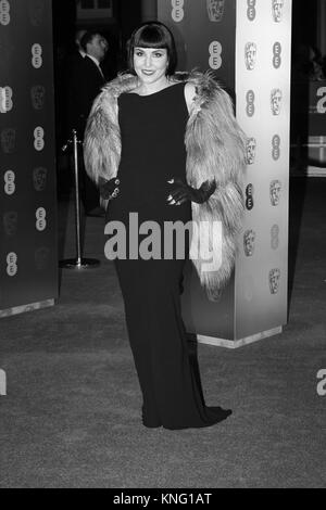 LONDON - FEB 12, 2017: ( Image digitally altered to monochrome ) Noomi Rapace  attends The EE British Academy Film - Stock Photo